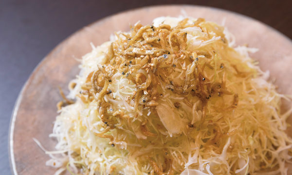 Cabbage salad with small fish